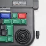 Enterprise 128 a sundaný klobouček na joystick